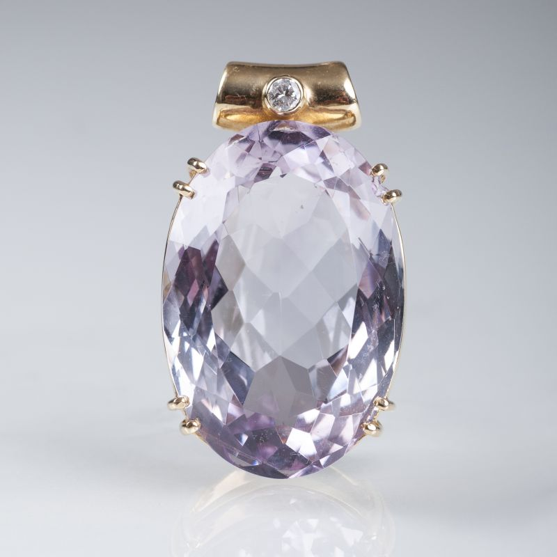 A large amethyst pendant with diamond