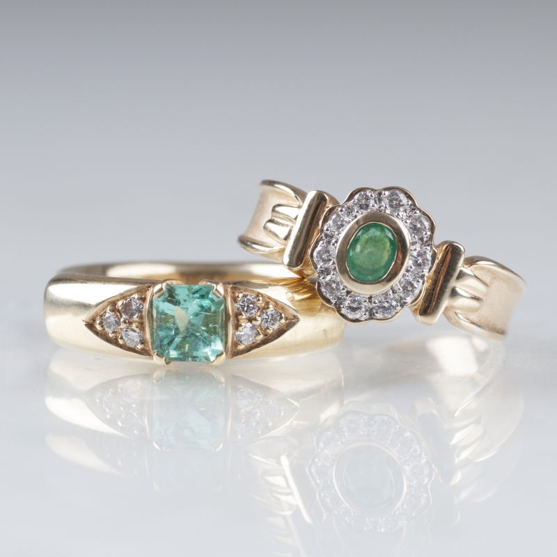 Two emerald diamond rings