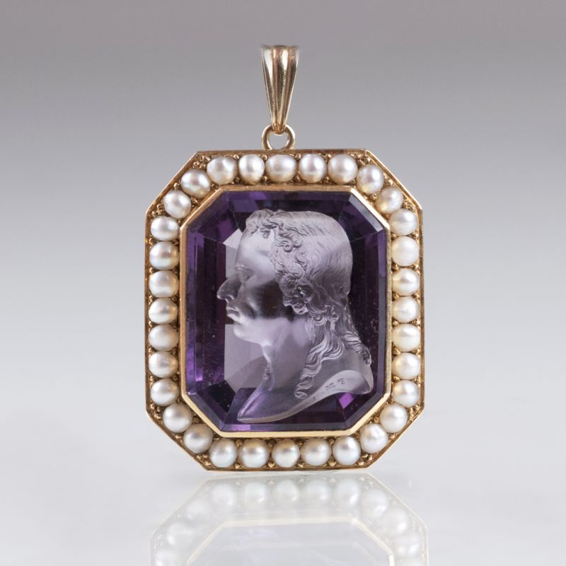 An antique cameo pendant with gentleman's profile and seedpearls