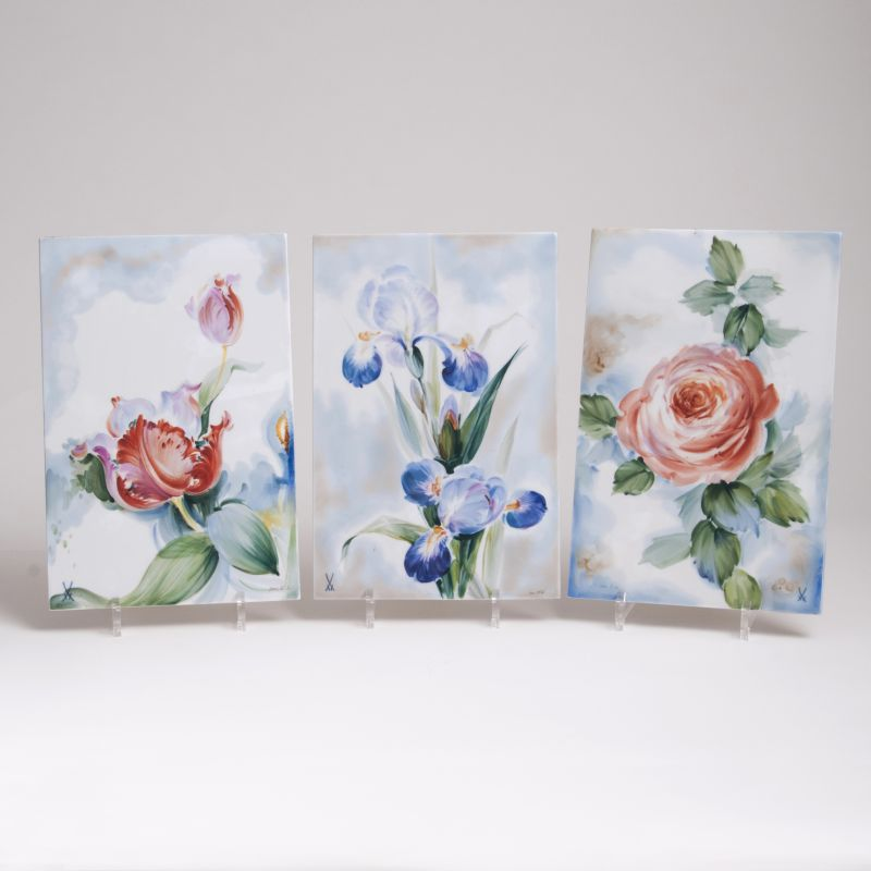 A Set of Three Porcelain Plaques with Flowers