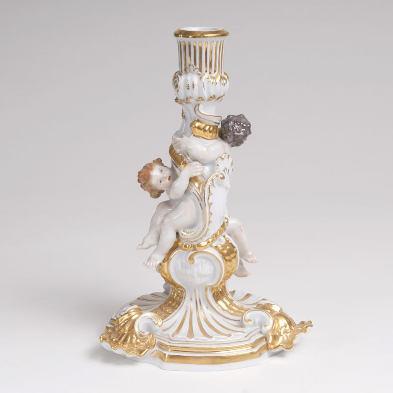 A Porcelain Figural Candlestick with Cupids