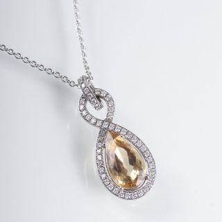 A gold beryll diamond pendant with necklace
