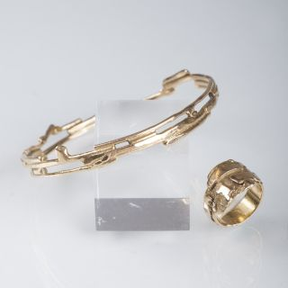 A golden bangle with matching ring