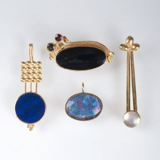 Four gold pendants with coloured stones