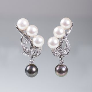 A pair of pearl diamond earclips