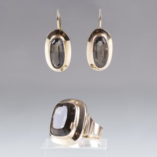 A gold smoky quartz ring with matching pair of earrings