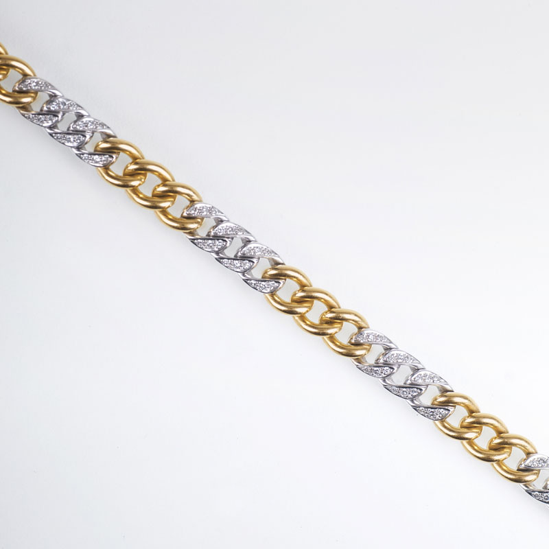 A two coloured golden bracelet with diamonds