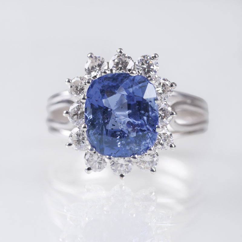 A precious ring with one natural sapphire and diamonds