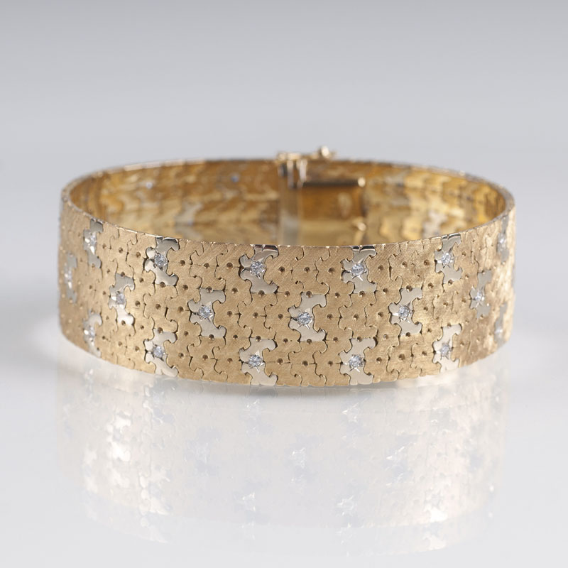 A two coloured Vintage gold bracelet with diamonds