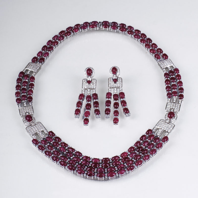 A highcarat ruby diamond demi parure with necklace and a pair of earrings