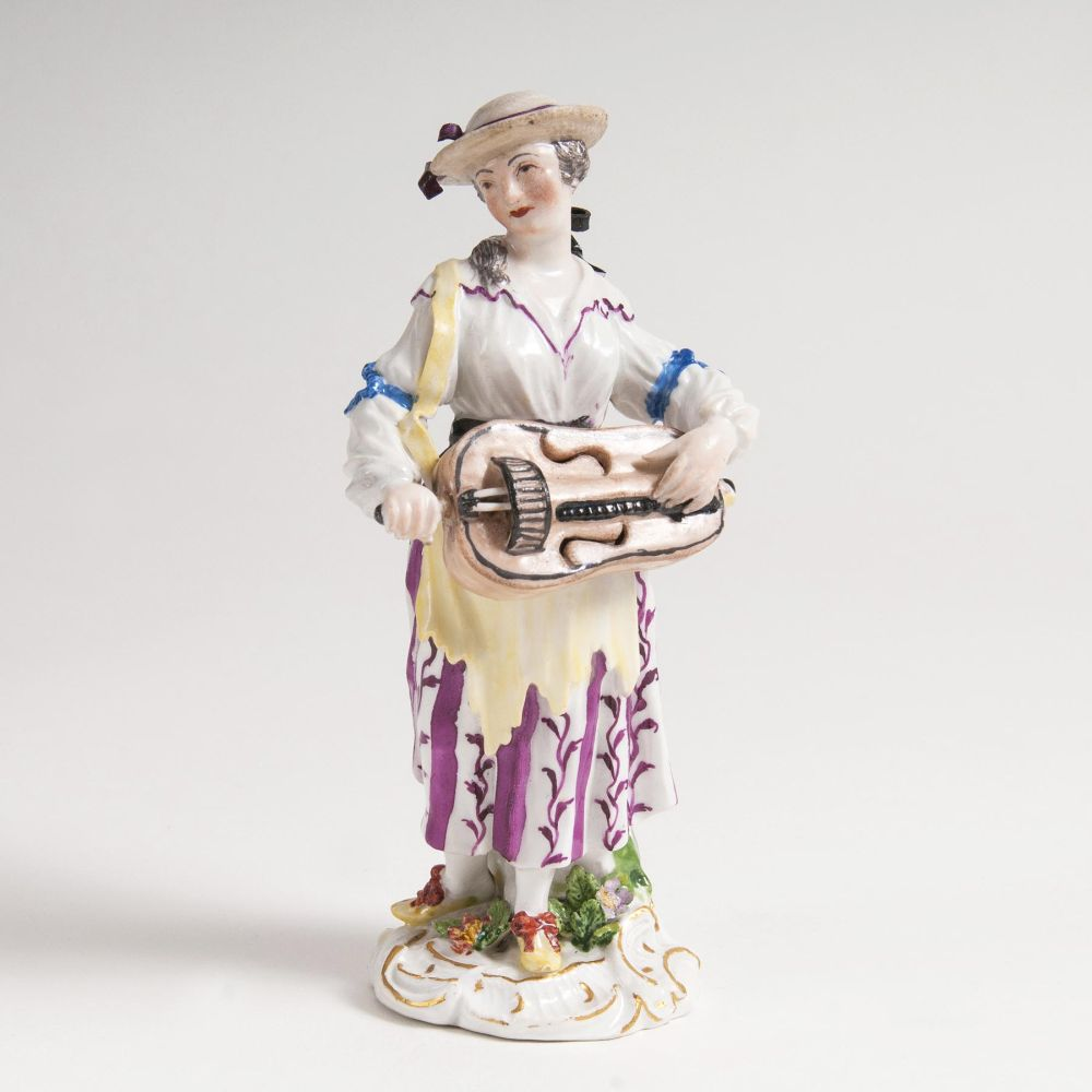 A Figure 'Girl with Hurdy-gurdy'