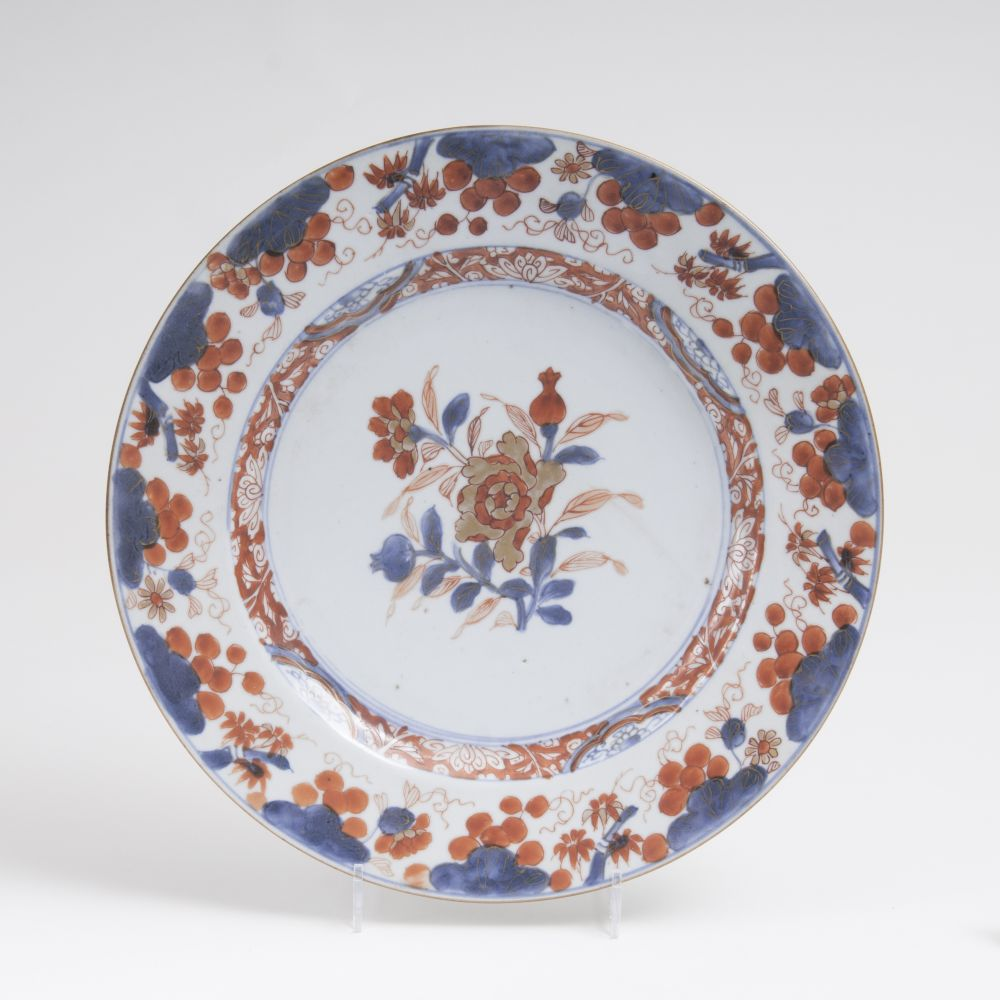 An Imari-plate with peonies and pomegranates