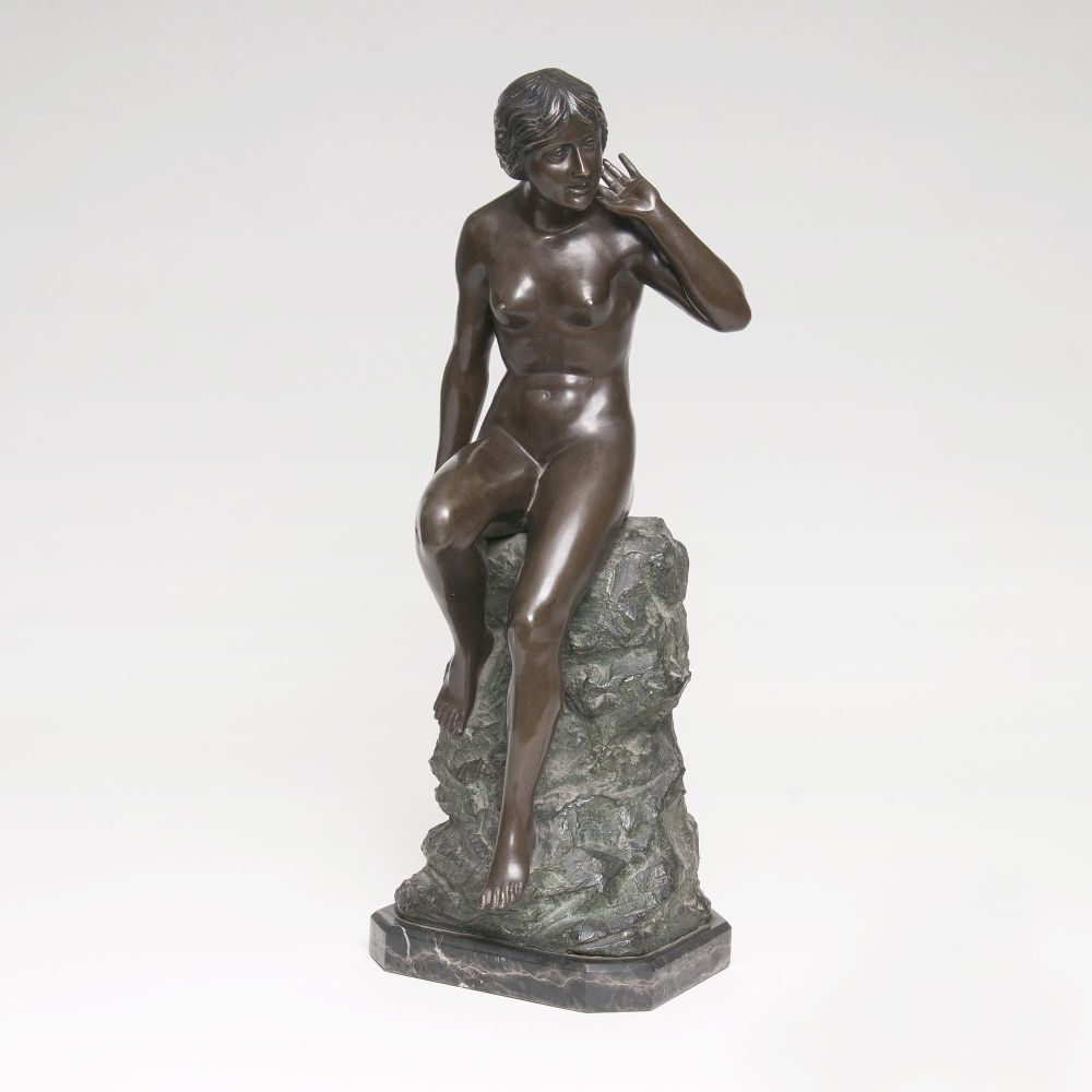 A Figure 'Female Nude sitting on a rock'