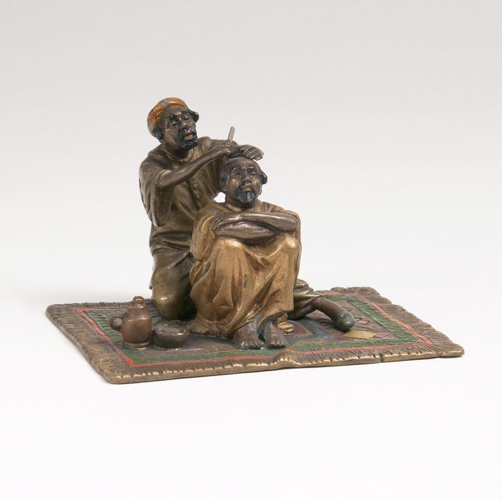 A Vienna Bronze 'At the barber'