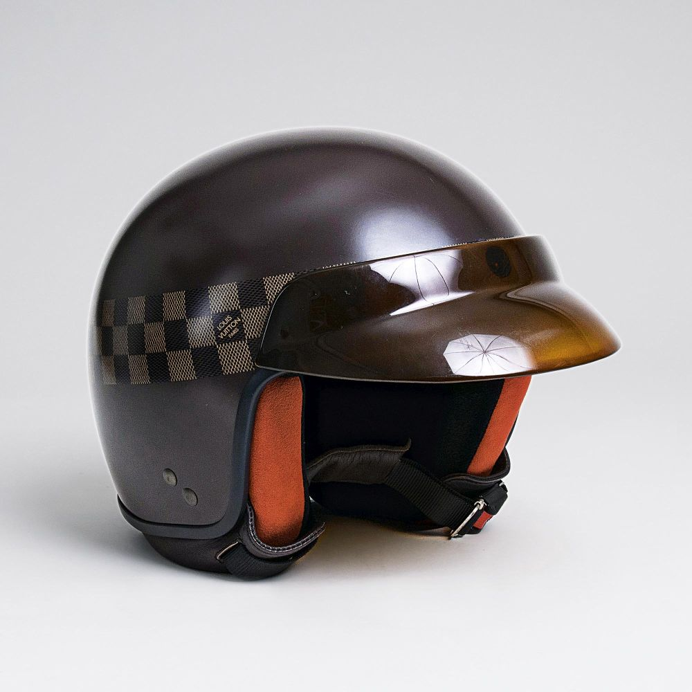 A 'Mini Jet GM' Motorcycle Helmet with Visor