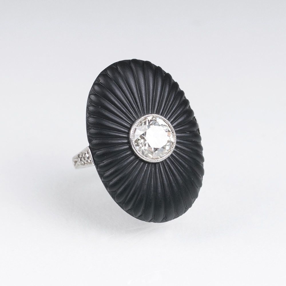An Art-déco Ring with Old Cut Diamond on Onyx