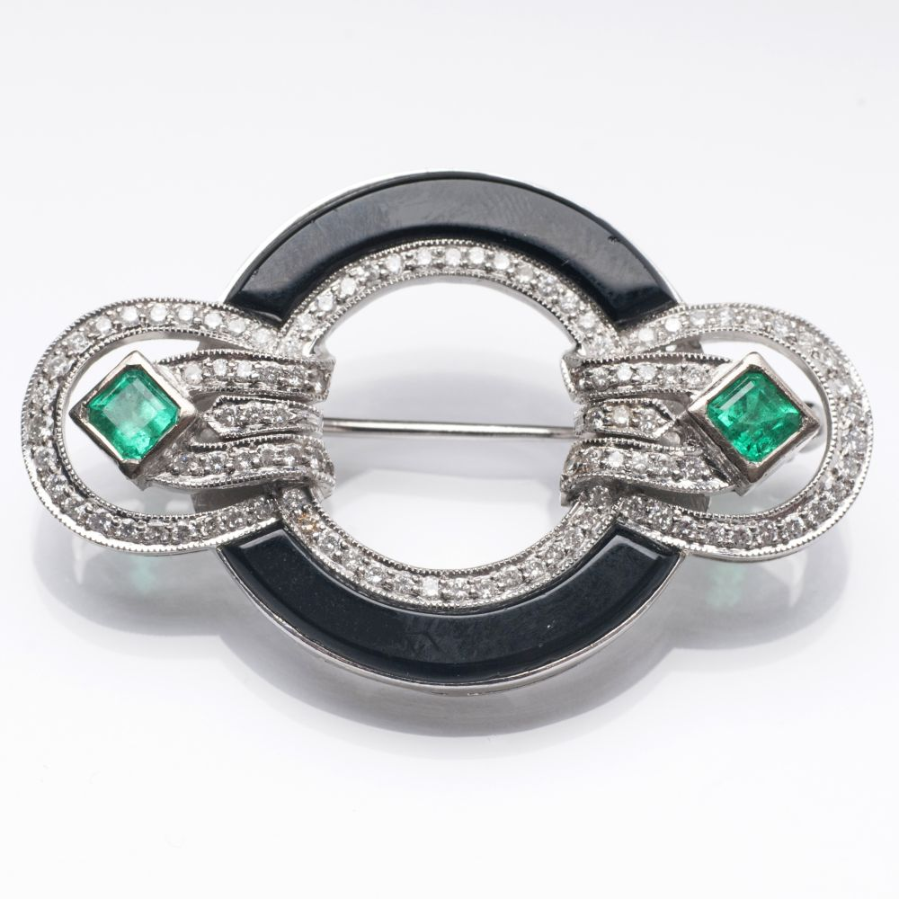 A diamond and emerald onyx brooch in Art-déco style