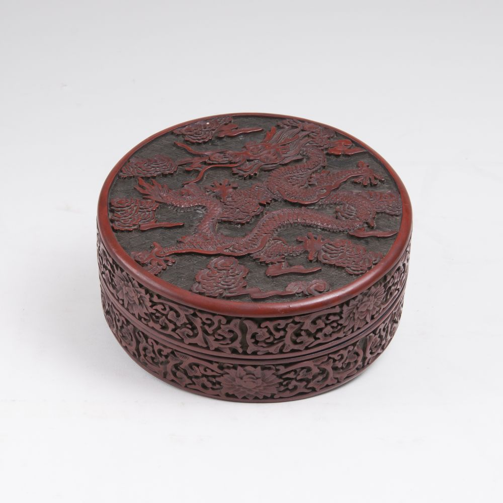 A Round Red Laquered Box with Dragon