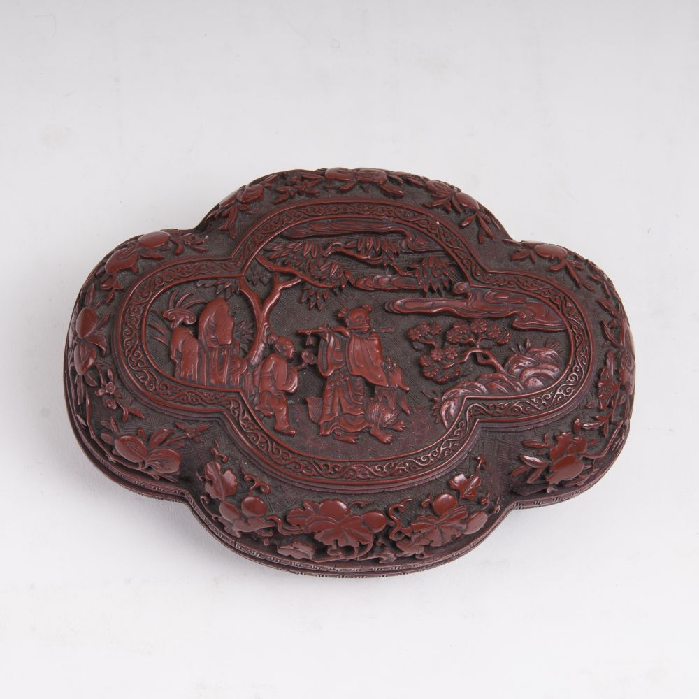 A Quatrefoil Red Lacquered Box with Figural Decor