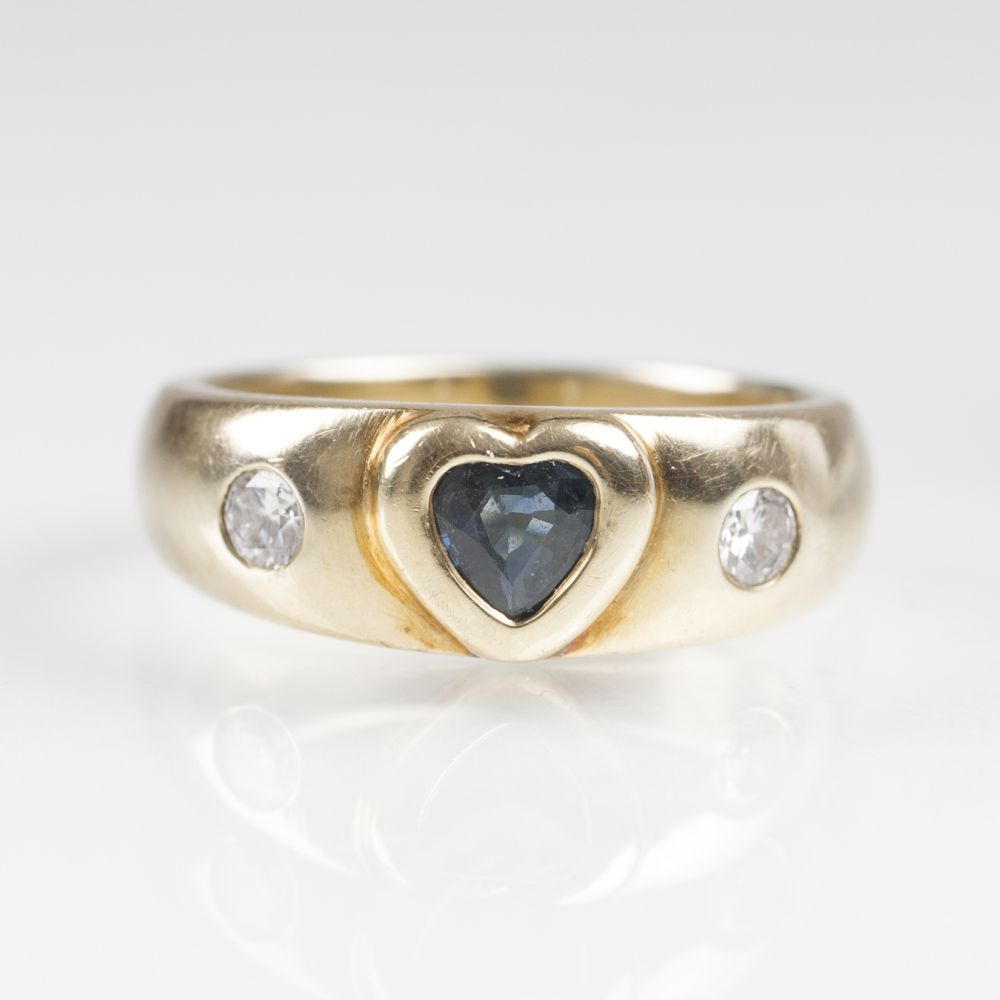 A Gold Ring with Sapphire Heart and Diamonds