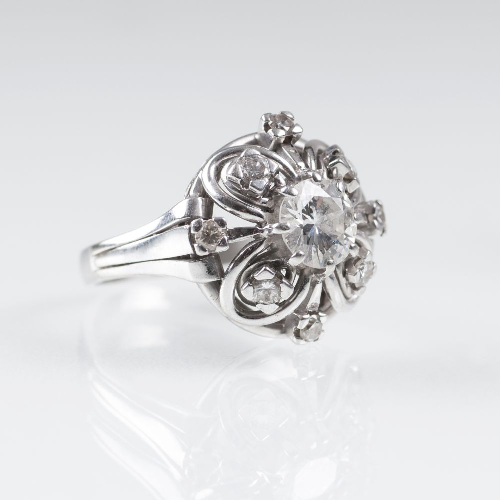 A large Solitaire Platinum Ring with Diamonds