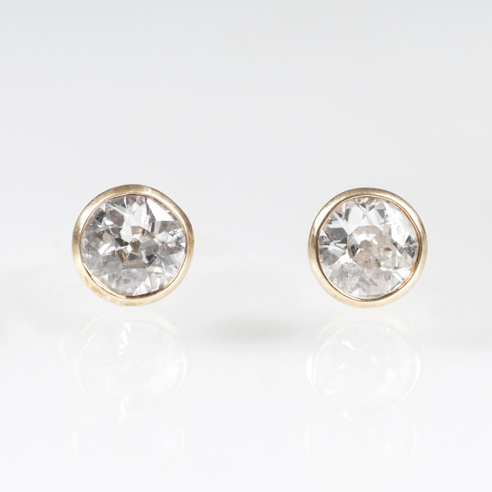 A Pair of Solitaire Earstuds with Old Cut Diamonds