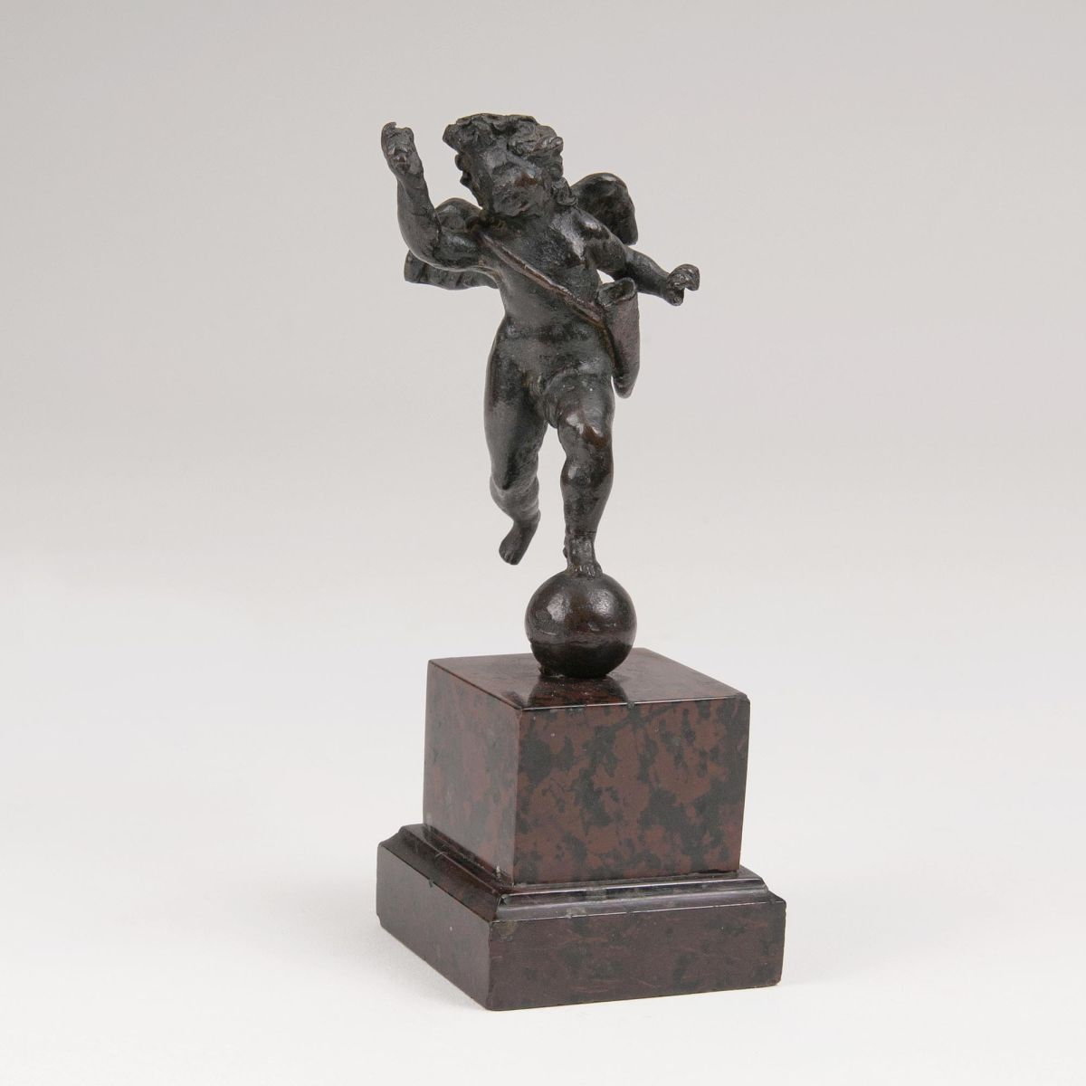 A Small Bronze 'Running Cupid'