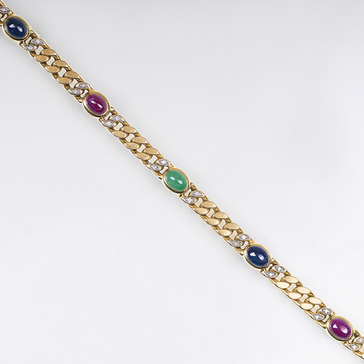 A Gold Curb Chain Bracelet with Gemstones