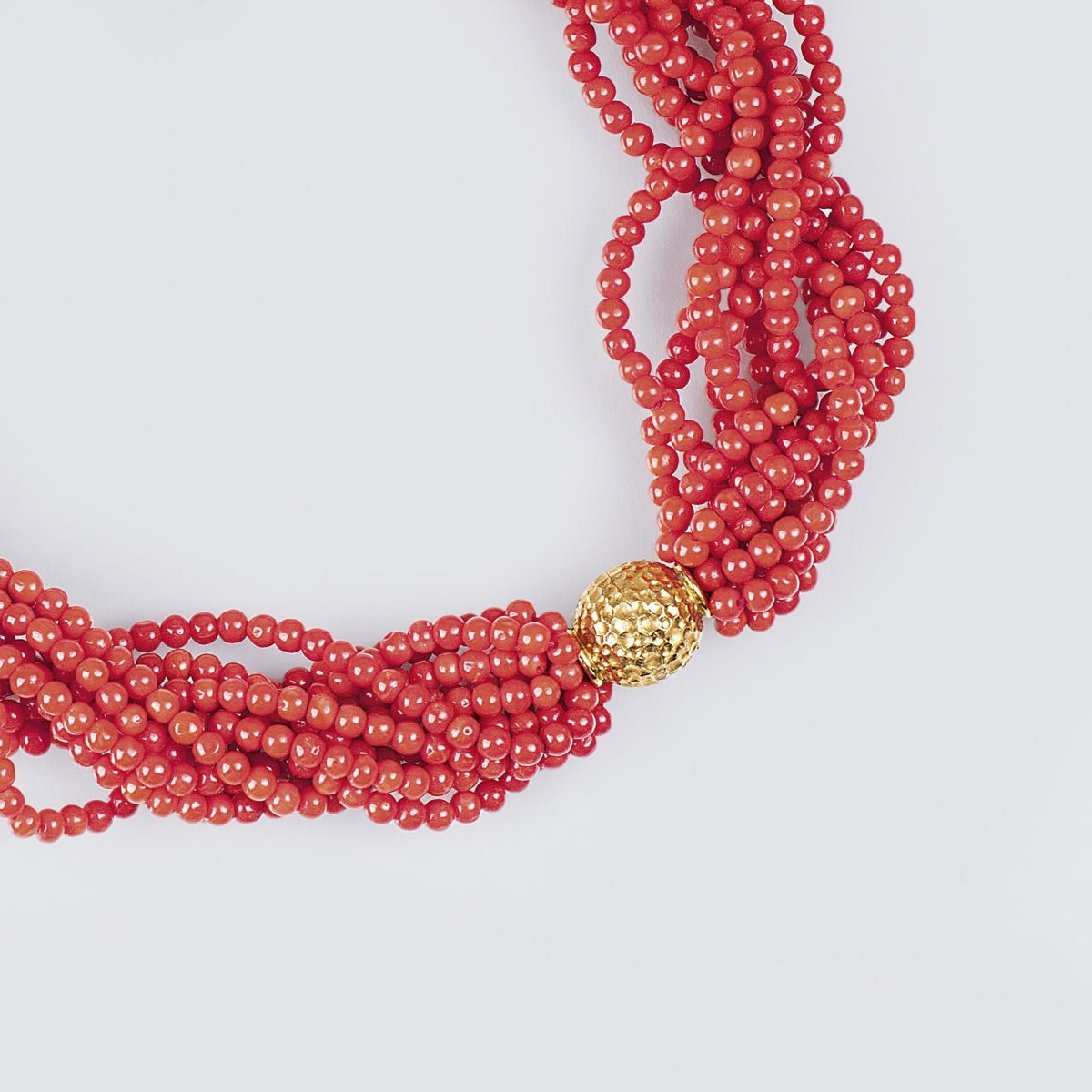 A Coral Necklace with Golden Clasp