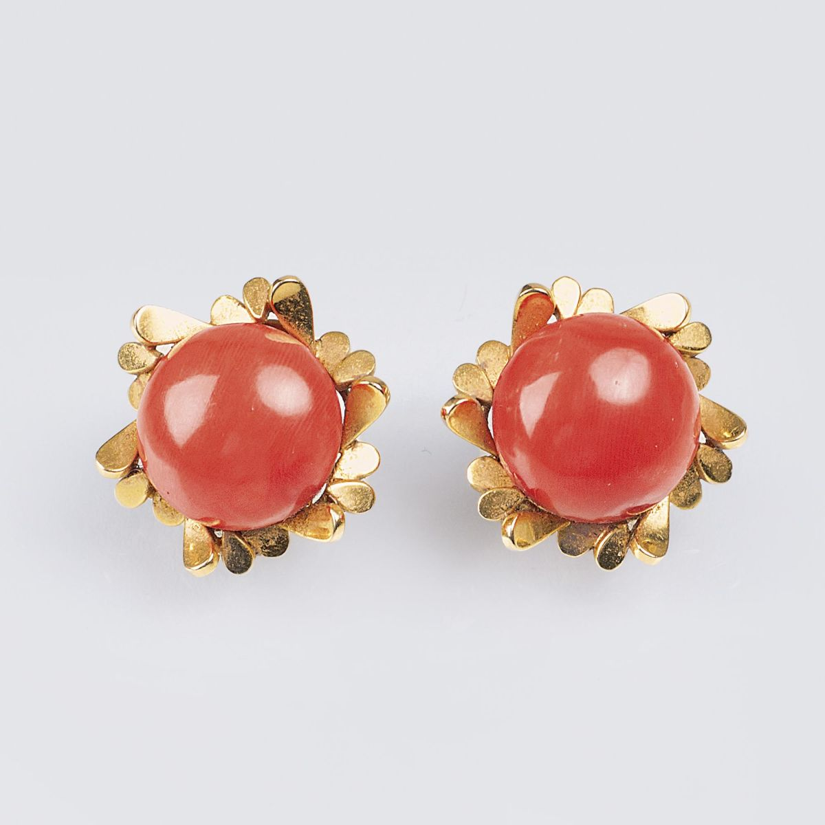 A Pair of Vintage Gold Earclips with Coral Setting