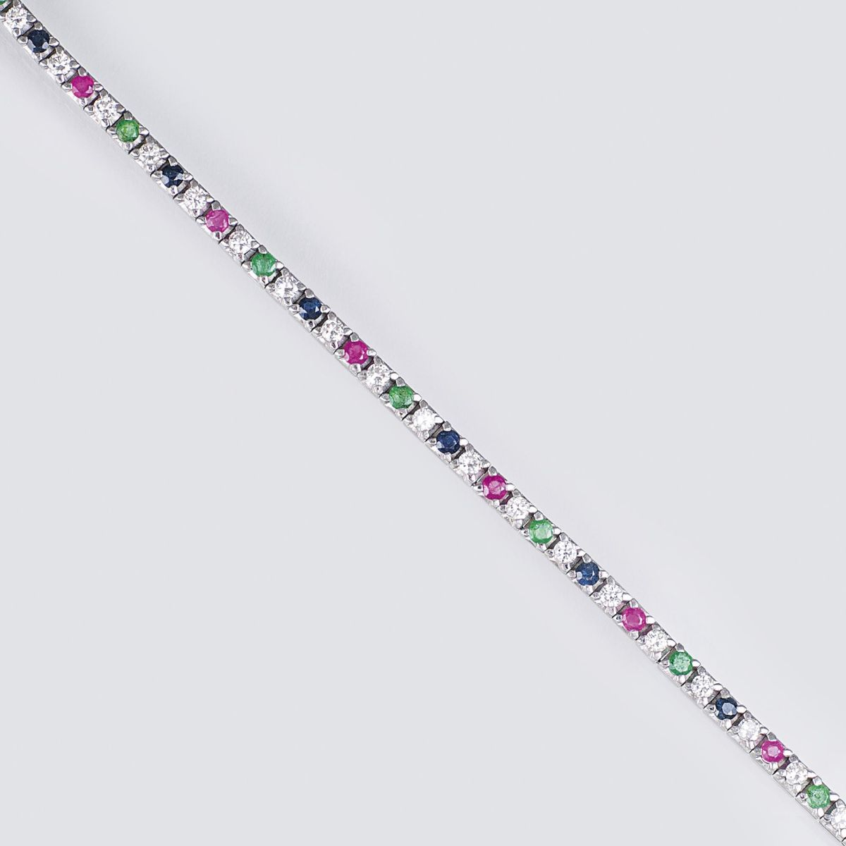 A Bracelet with Emeralds, Sapphires, Rubies and Diamonds
