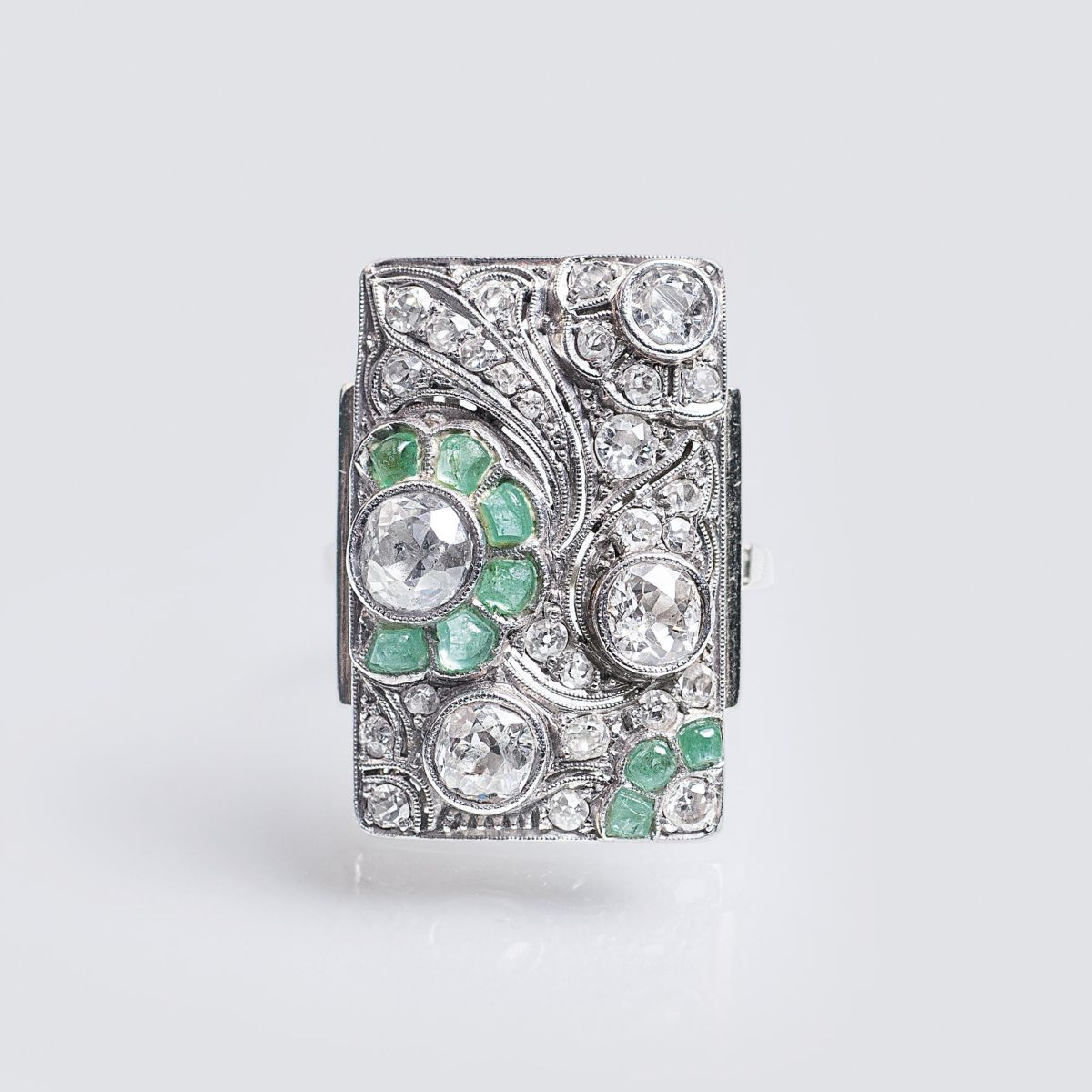 An Art-déco Ring with Old Cut Diamonds and Emeralds