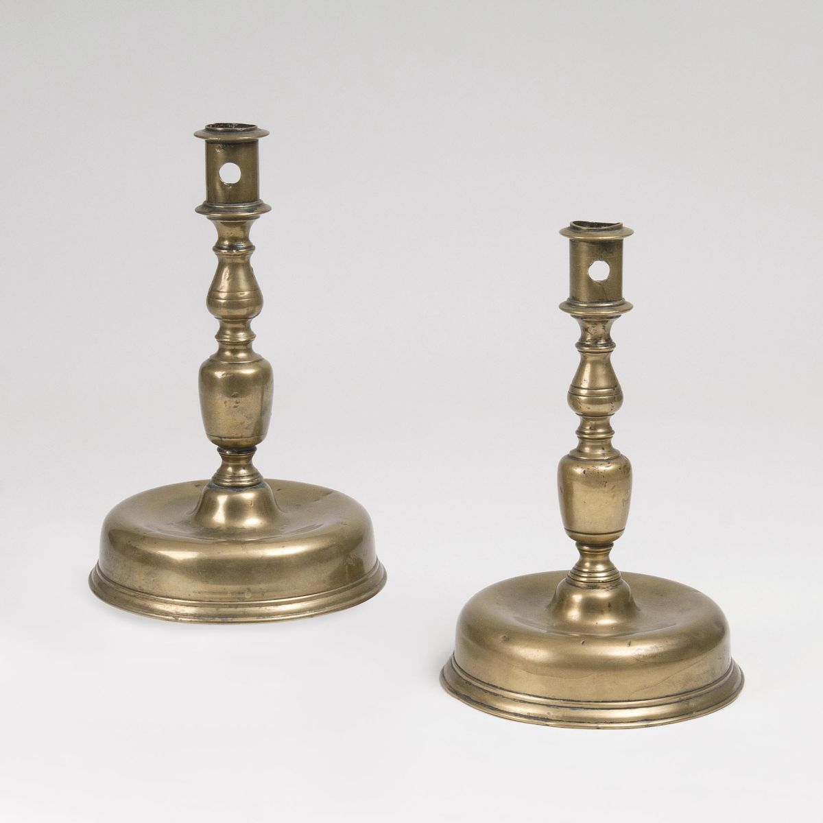 A Pair of Baroque Bell-shaped Candlesticks