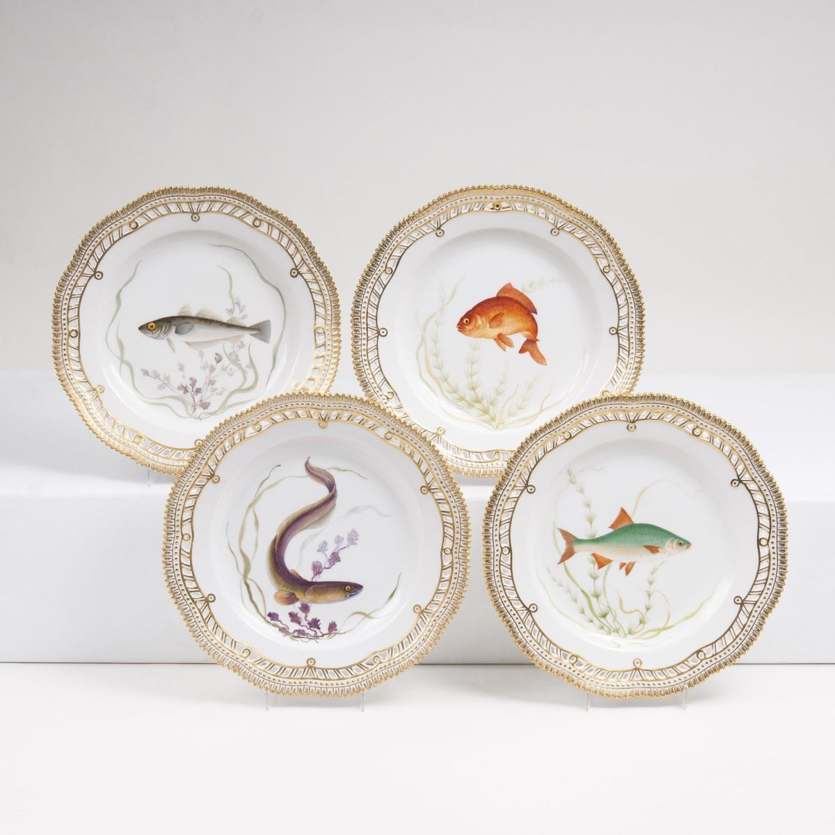 A Set of 4 reticulated Flora Danica Dinner Plates with Fish Specimen