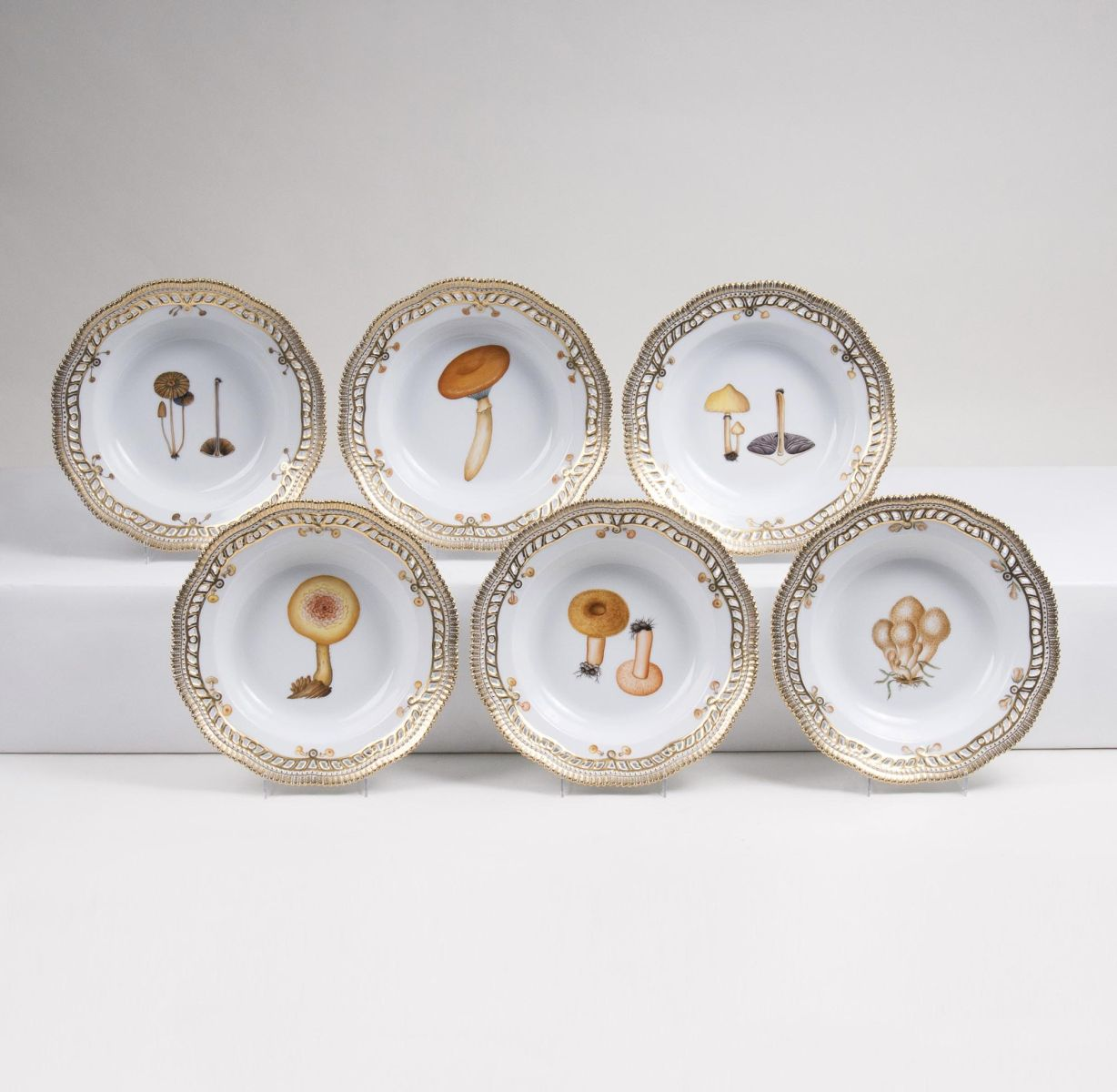 A Set of 6 reticulated Flora Danica Soup Plates