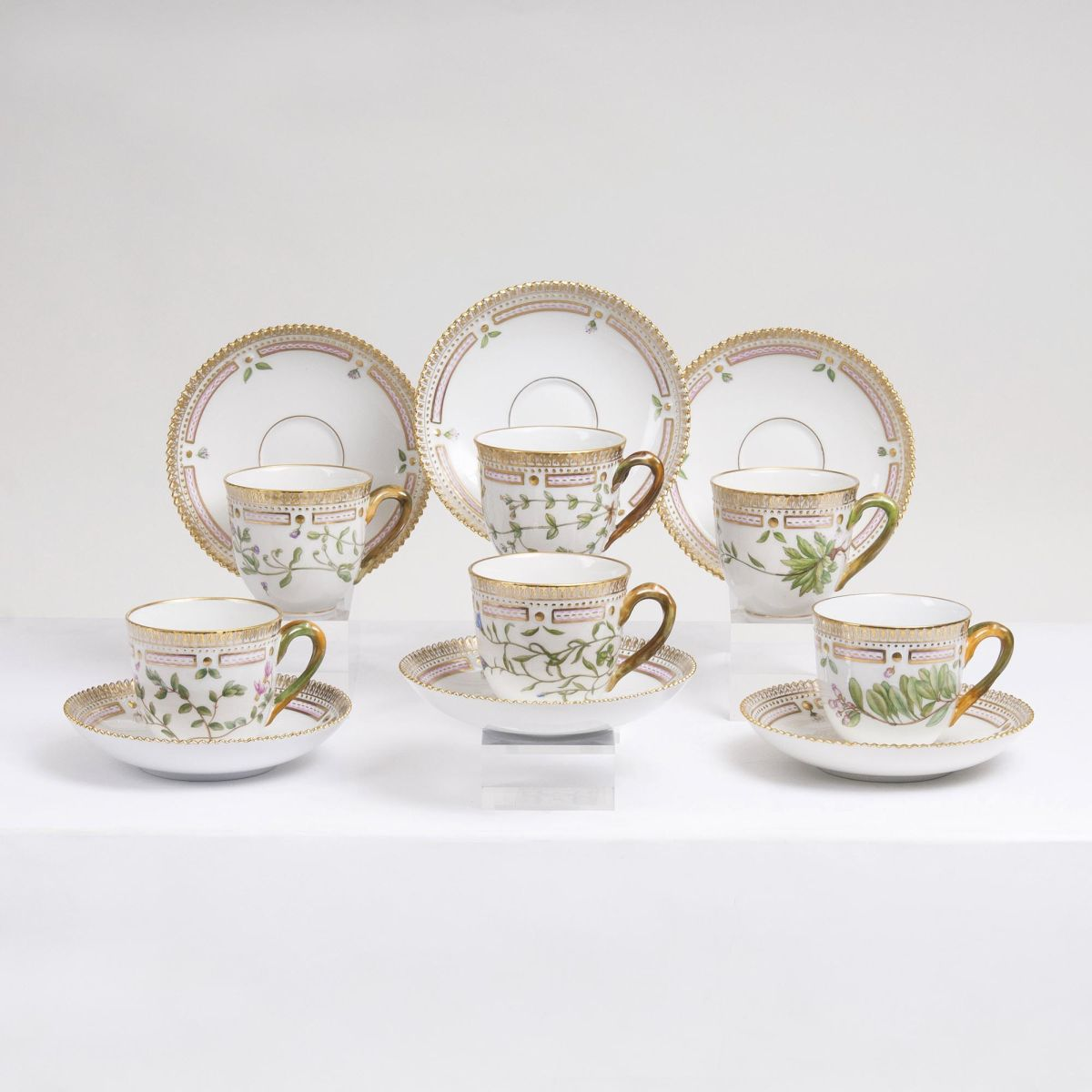 A Set of 6 Flora Danica Coffee Cups with 7 Saucers