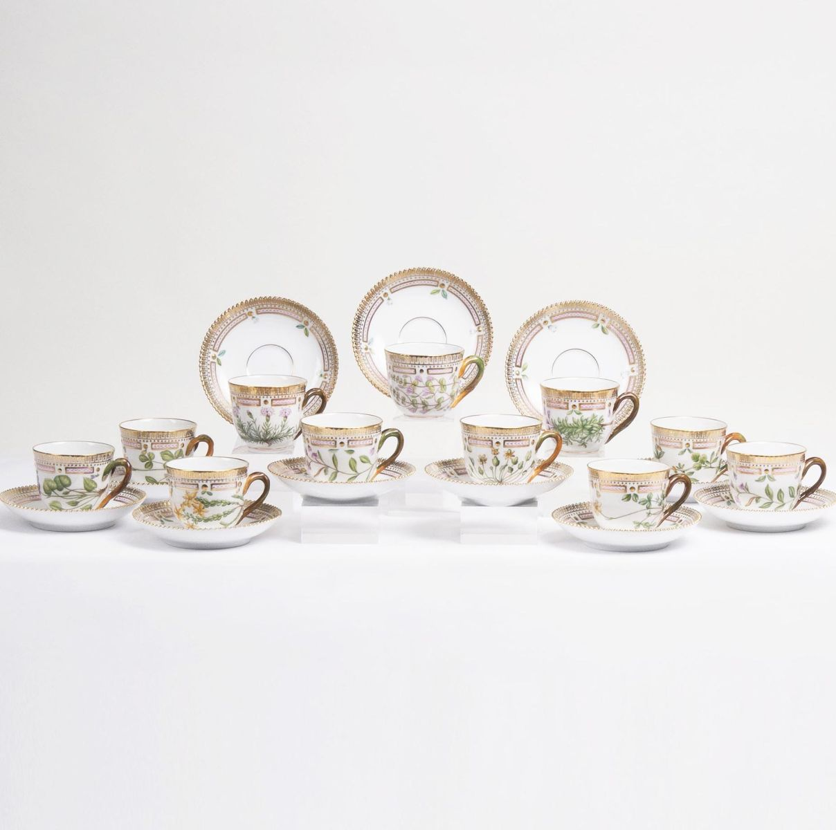 A Set of 11 Flora Danica Moccha Cups with 12 Saucers
