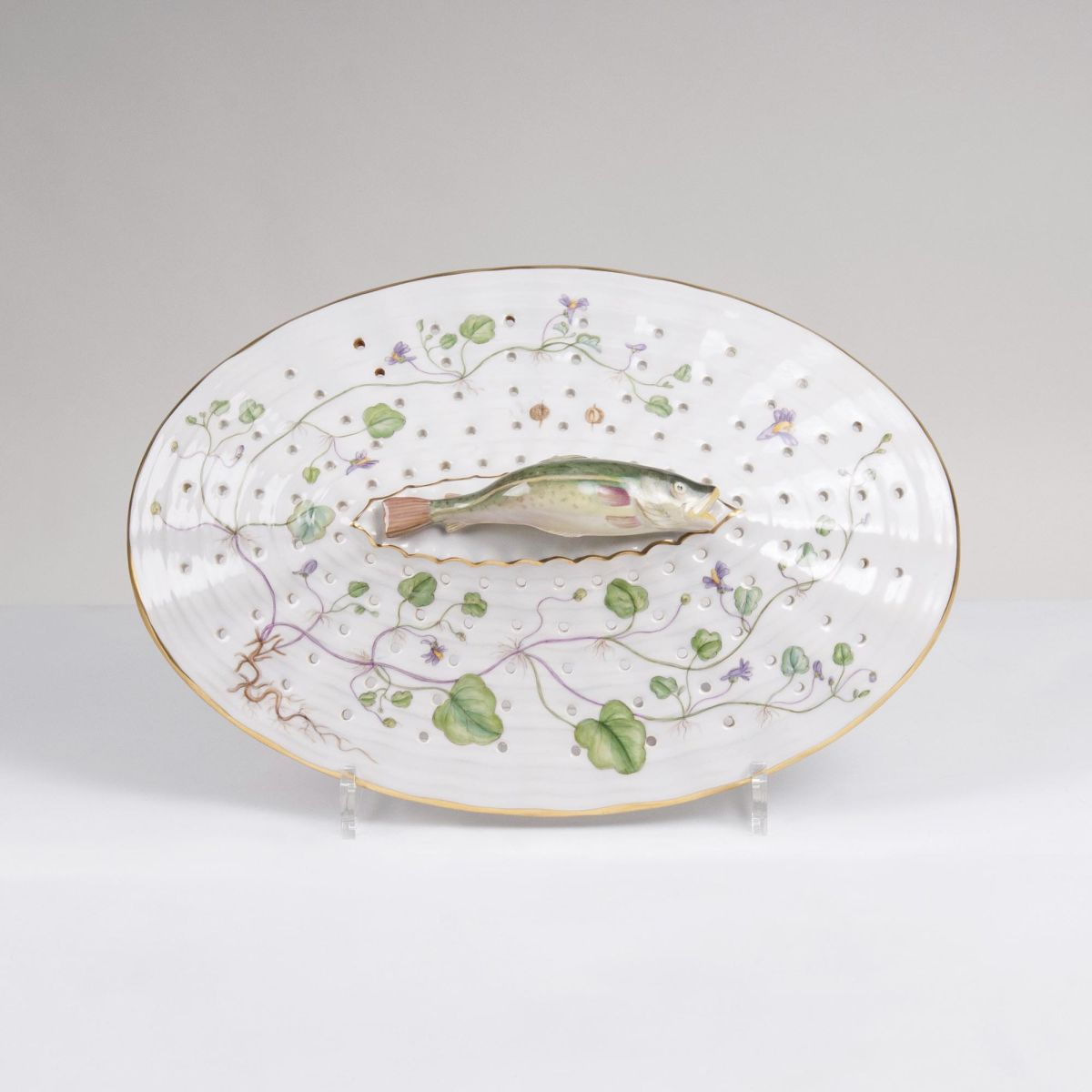 A reticulated Flora Danica Lid/Colander with Trout Handle