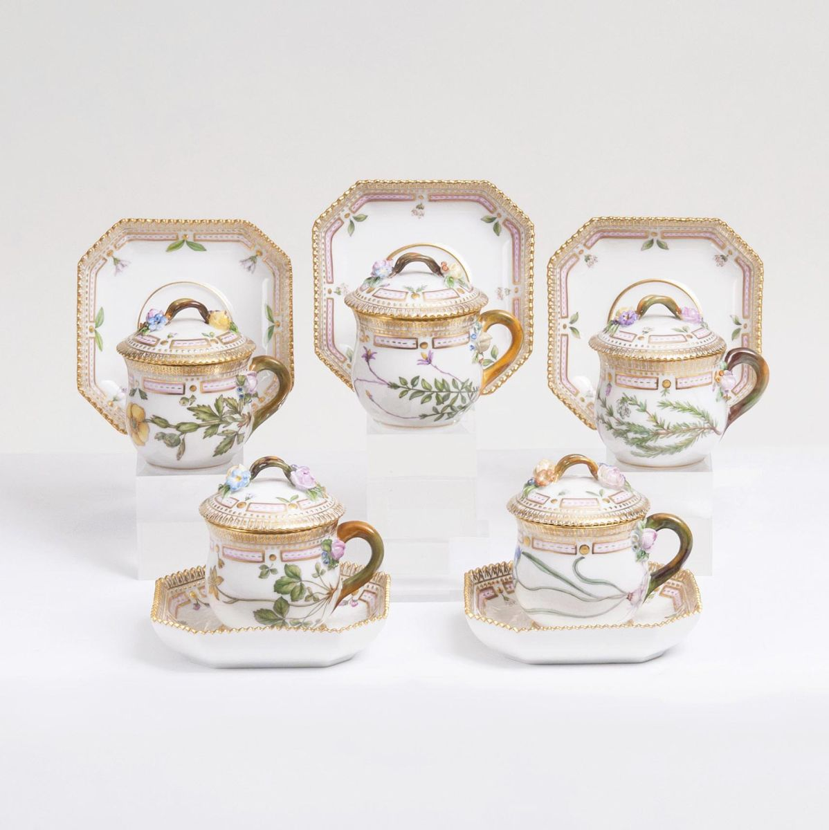 A Set of 5 small Flora Danica Lidded Bouillon Cups with Polygonal Saucers