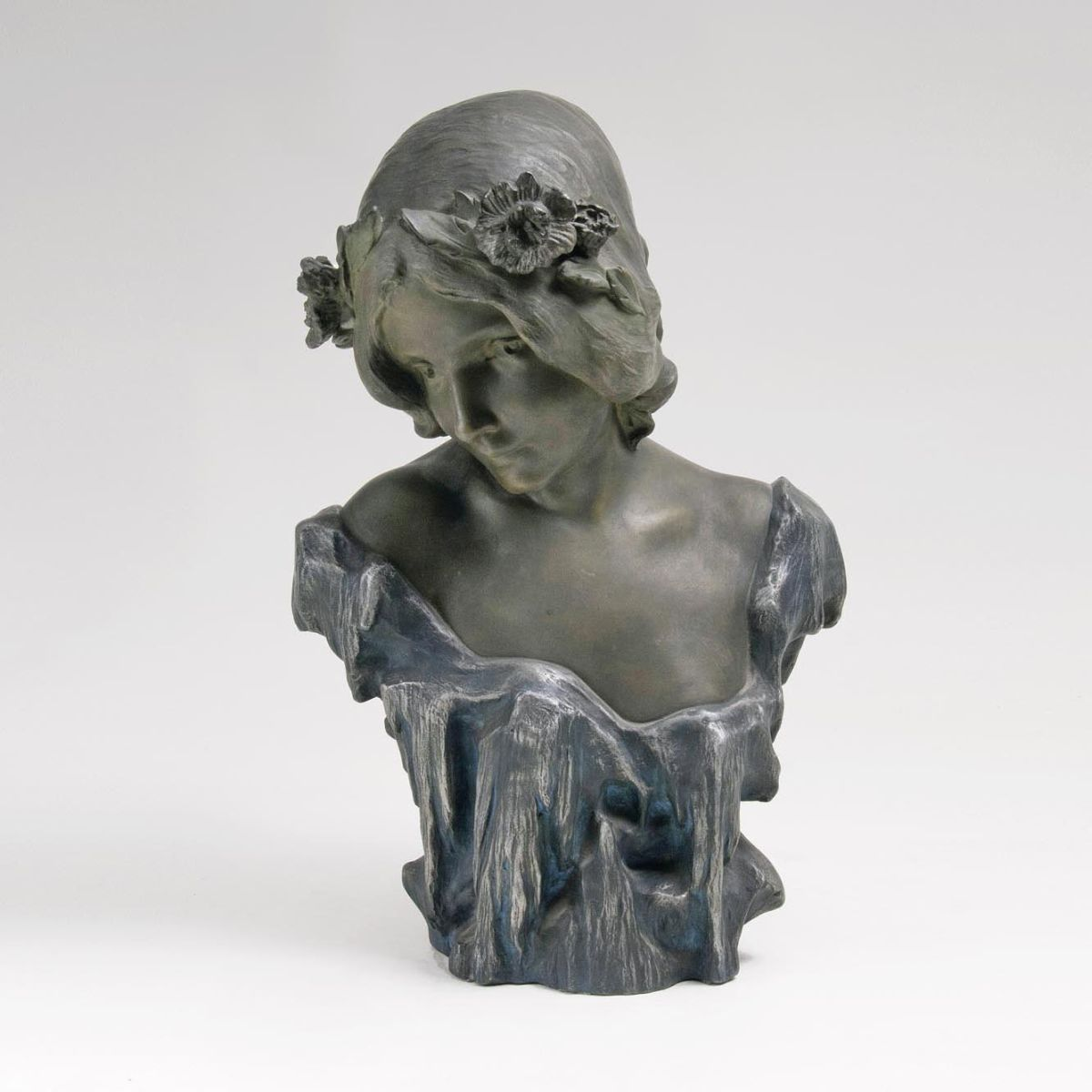 An Art Nouveau Bust of a Nymph with Flowers in the Hair