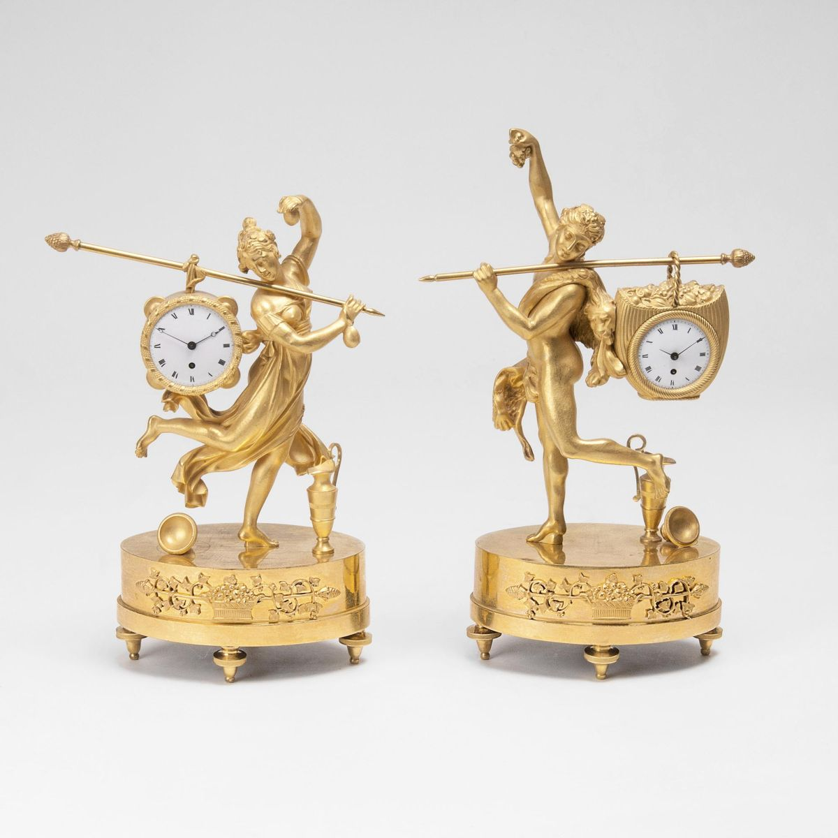 A very rare Pair 'Le Porteur' Empire Tableclocks 'Dancing Omphale' and 'Hercules'