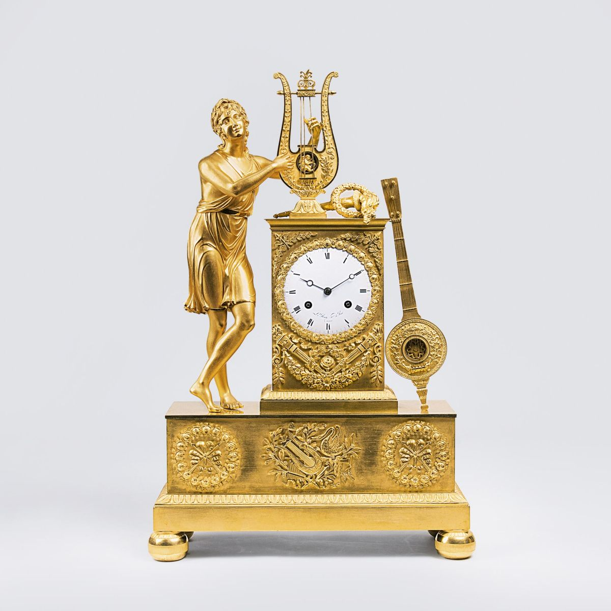 An Empire Pendule 'Orpheus singing of Love'