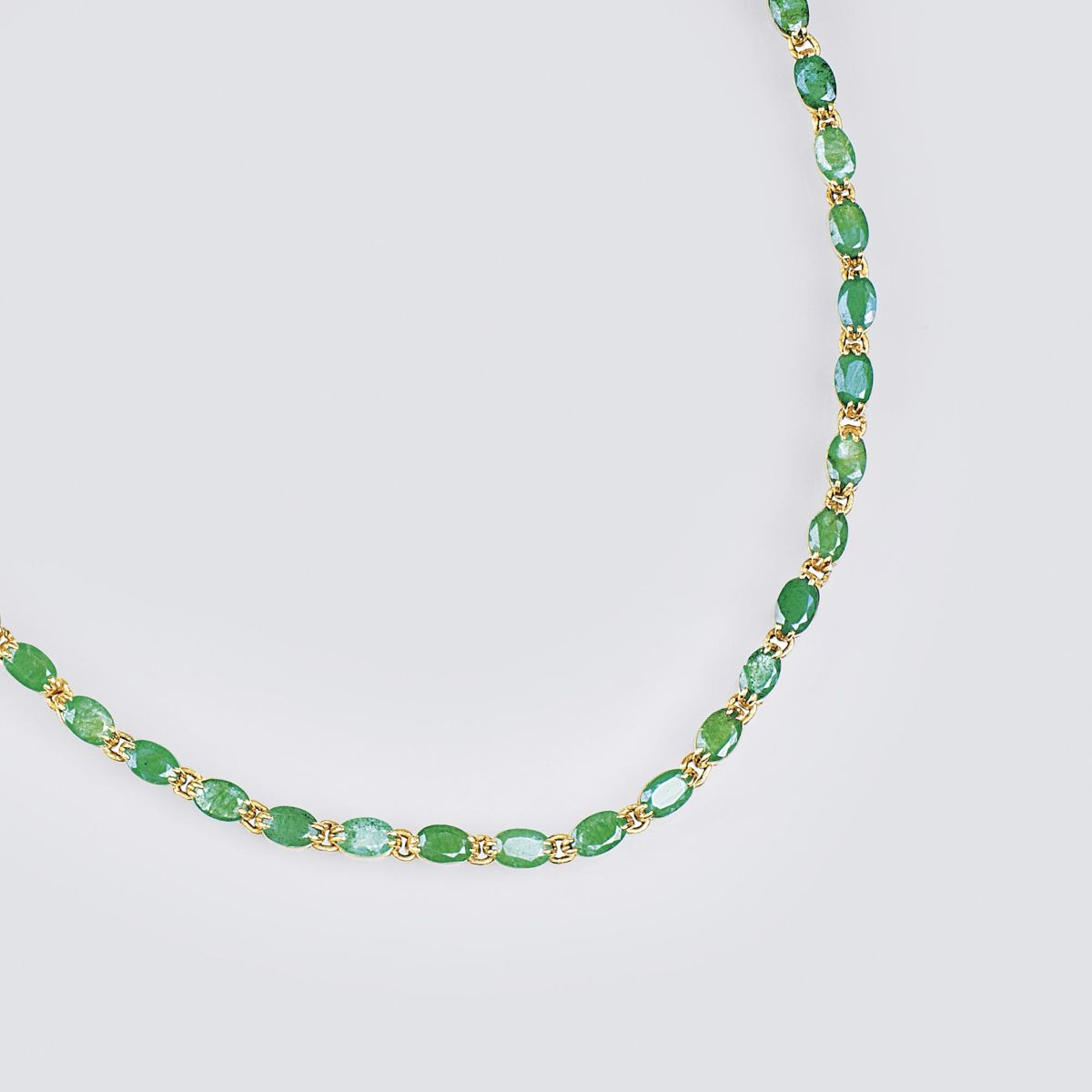 A Gold Necklace with Emeralds