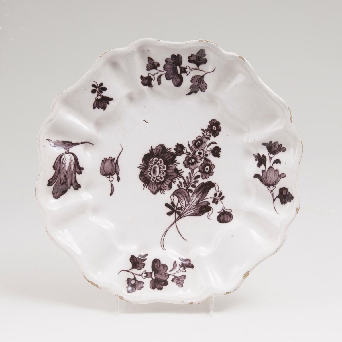 A Faience Plate with Manganese Flower Painting