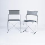A Pair of Design Classics 'Nuova X Line Chairs'