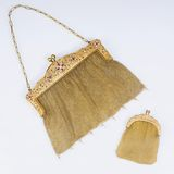 A golden Art Nouveau Purse with Diamonds and Rubies and a small Wallet