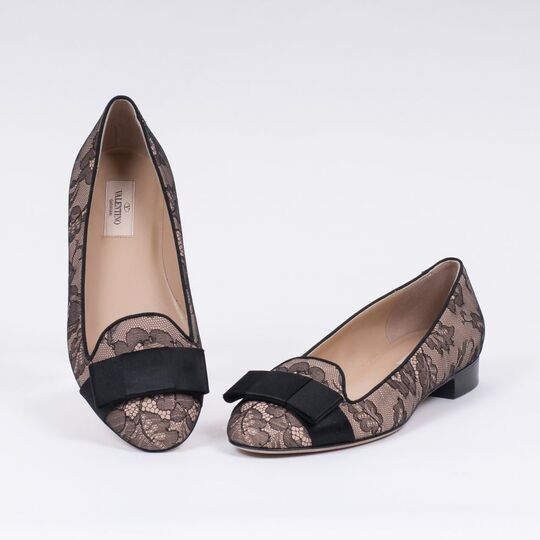 A Pair of Ballerinas with Black Lace