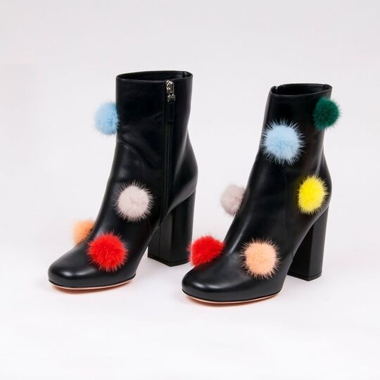 A Pair of Black Leather Booties Pom Pom