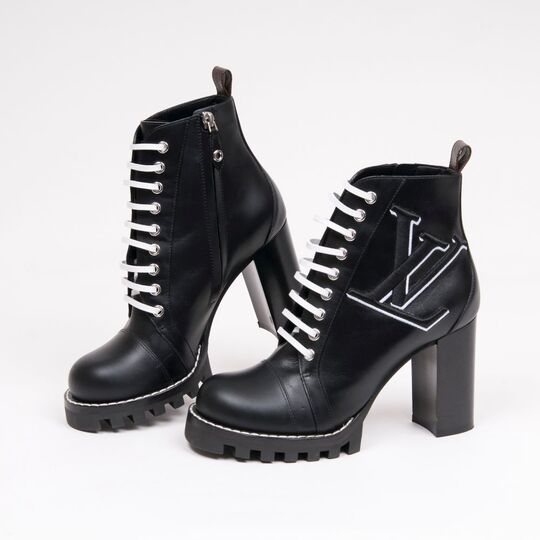 A Pair of Laced Star Trail Ankle Boots