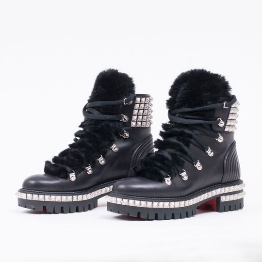 A Pair of Laced Studded Boots Yeti Donna